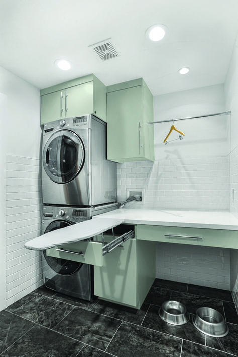 to save some space use stacked washer and dryer and a hideaway ironing board