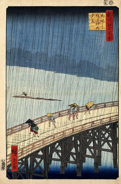 Ohashi Atake no Yudachi (Sudden shower over Shin-Ōhashi bridge and Atake). Ukiyo-e print shows pedestrians crossing the great bridge at Atake during a rain storm. No. 52 in the series Meisho Yedo Hiakkei (One Hundred Famous Views of Edo), 1857.