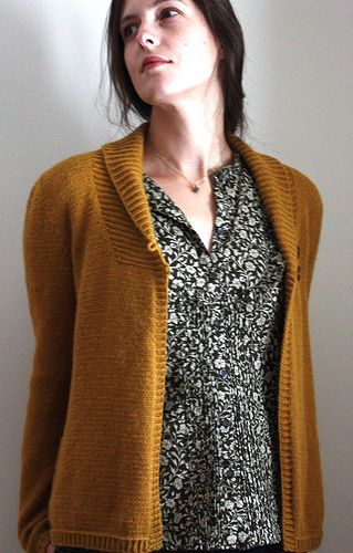 A hip length cardigan with a shawl collar and 2-button closer that can be worn comfortably open or closed.