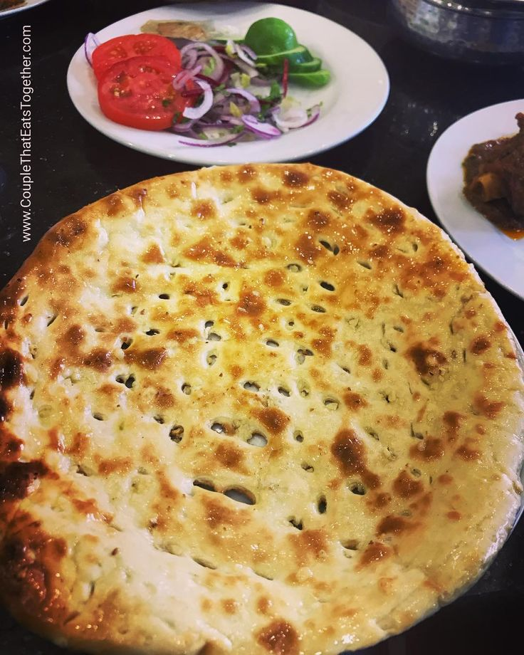 ROGINI NAN : a huge tandori nan with sprinkled with white sesame seeds & glazed with butter. Goes well with Mutton Karahi. Location: Student Biryani Kuwait Street Al Karama  Dubai. #couplegoals #couplethateatstogether #tandoor #nan #whitesesame #grand #huge #socialenvy #tastyfood #aroundtheworld #dubai #pakistani #studentbiryani @studentbiryani.dubai #loveoffood #yummyfood #dubaifoodie #butter #biryani #mutton #kadhai #sides #amazingtaste #somethingdifferent #foodexplore #foodblogger…