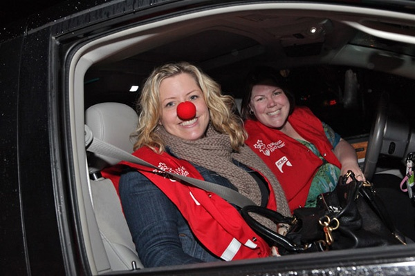 Nose for success: From left: volunteers Jenny O1Callaghan and Sharon Perry smile as they head out on their rounds for Operation Red Nose, which kicked off in New Westminster and Burnaby last weekend. The program will run on weekends all through December.