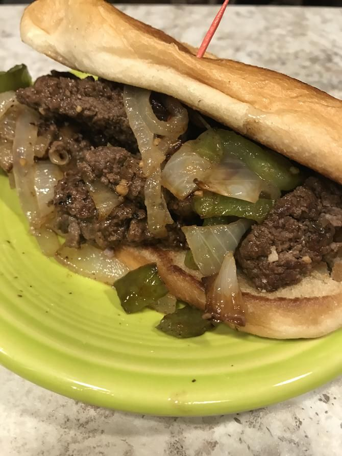 Pepper Steak Sandwiches        INGREDIENTS:    4 cube steaks (tenderized round steak)    1 medium onion, sliced    1 green bell pepper, chopped    1 tablespoon (or more) Montreal steak seasoning    1 stick butter, divided    1/4 cup Worcestershi...