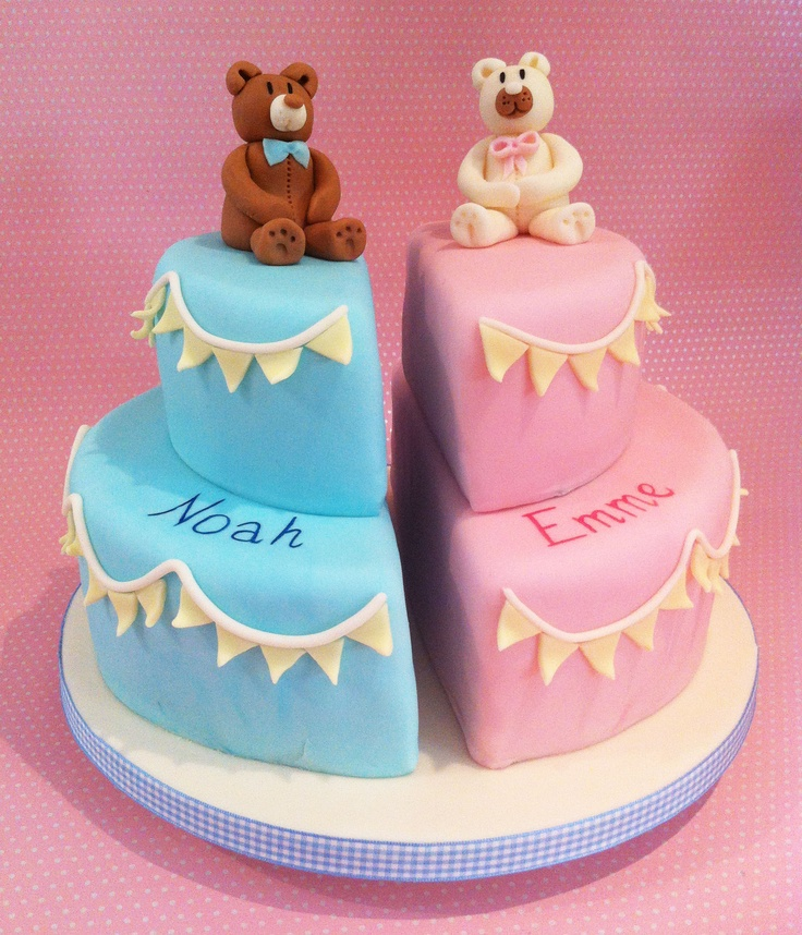 The split-cake design is a stylish solution for creating a christening cake for twins