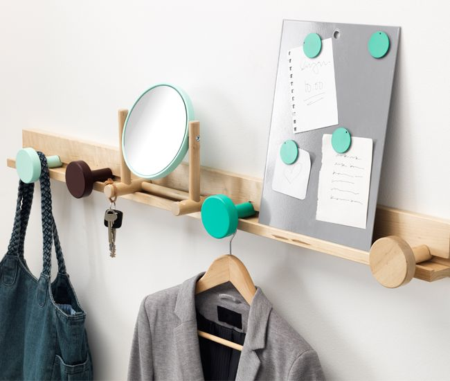 IKEA's entryway organizer provides a place for your keys, coat and bag. A magnetic board puts notes at eye level, while an adjustable mirror allows for a last-minute spot check.