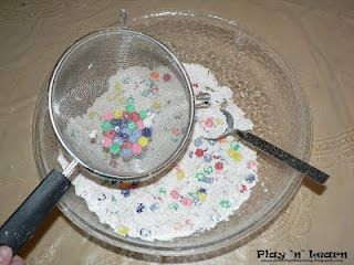 Sifting beads buried in flour...fun...till they start throwing the beads and digging in the flour lol