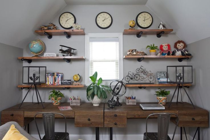 This home office features floating shelves adorned with fun childhood toys. Two desks are put together for a work space that both kids and adults can enjoy.