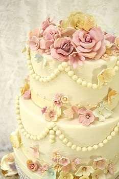 Vintage bead and flowers cake. This company makes beautiful tiered cakes and cupcakes.