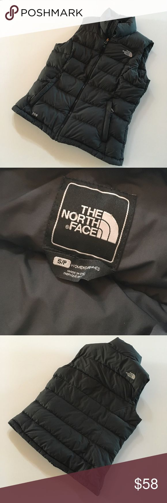 North Face black down puffy vest size small Cozy and classic! Size small puffy goose down feather vest from the North Face. Gently worn. North Face Jackets & Coats Vests