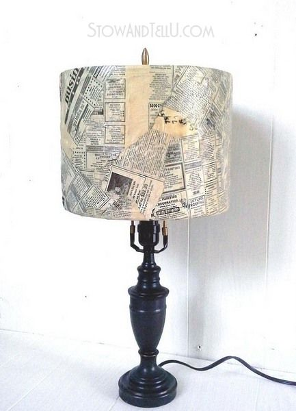 Old lamp shade is covered with newspaper and decoupage.  This look would work well in an ecclectic home. StowandTellU.com