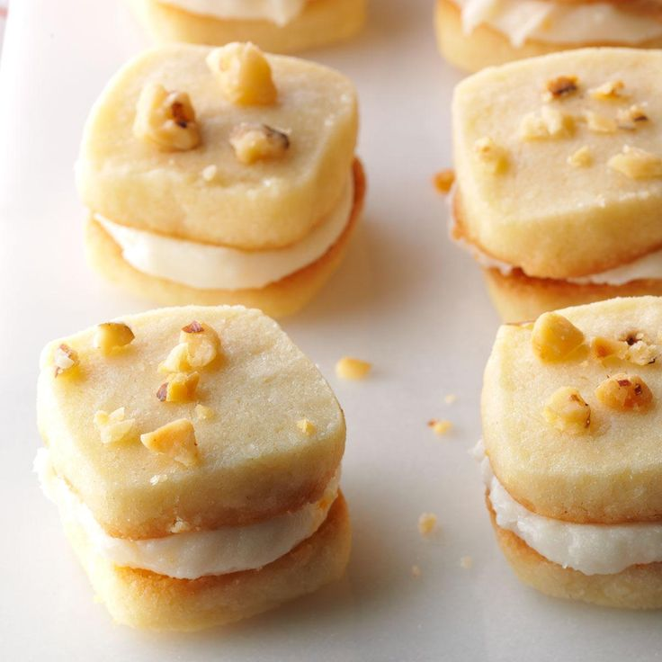 Lemon Tea Cookies Recipe -These sandwich cookies taste rich and buttery and have a lovely lemon filling. The recipe has been in our family since the 1950s, when my mother got it from a French friend in her club. —Phyllis Dietz, Westland, Michigan