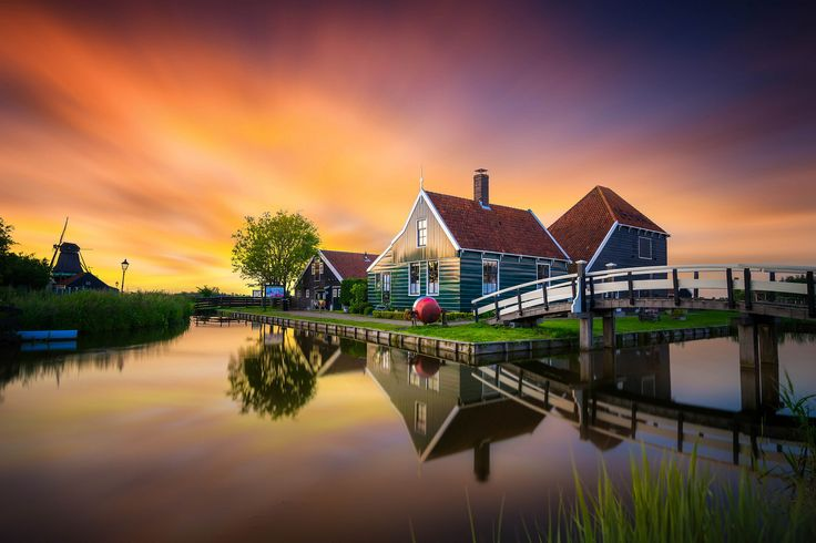 https://flic.kr/p/ugNcGr | Typical Dutch! | Zaanse Schans, The Netherlands.  This was taken last week right after sunset. Zaanse Schans is a famous windmill village in the Netherlands that attracts many tourists. This spot has been photographed countless times, but this was my first time at this particular spot!  Shot with Sony A7II, Zeiss 16-35 FA, F5, ISO 320, 13 seconds. Had to manually hold the filter in front of the lens because I don't have my filter holder yet, that's why the…
