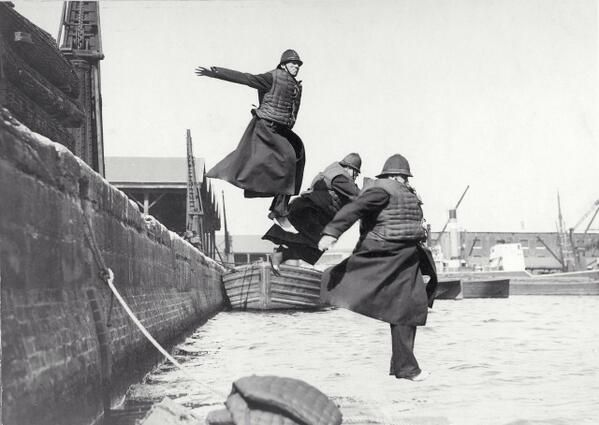 Who needs a swimming pool when you have West India Docks? London police test their life jackets in 1930