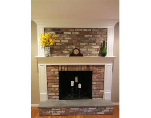 brick fireplace trimmed out, I would love to do the mantle of my fireplace like this, but leave the above brick exposed.