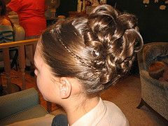 first communion hair styles | Updos just tend to look a little more polished and elegant.