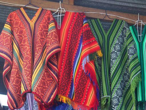 Great examples of some radical ponchos for the festival!