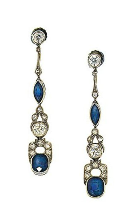 A pair of early 20th century sapphire and diamond earrings  Each old brilliant-cut diamond surmount suspending a tapered drop set with a marquise-cut and cushion-shaped sapphire between diamond-set openwork links, circa 1925, 5.0cm long