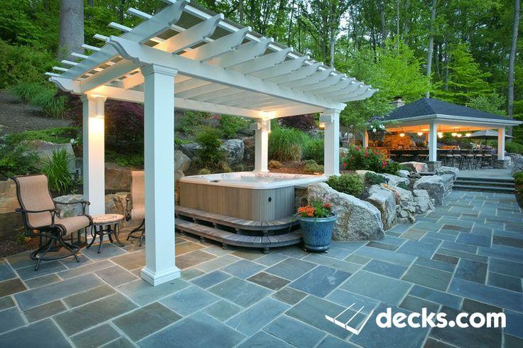 White Pergola over a hot tub.  Flagstone patio.  A classy project in MD.