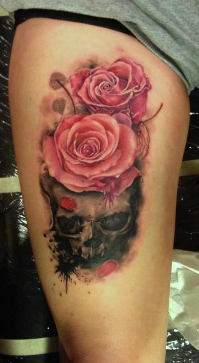 Awesome tattoo - skull with roses. I want so bad! But don't have the guts to do it. :/ but a sleeve tat. Ahh and my mom would kill me!