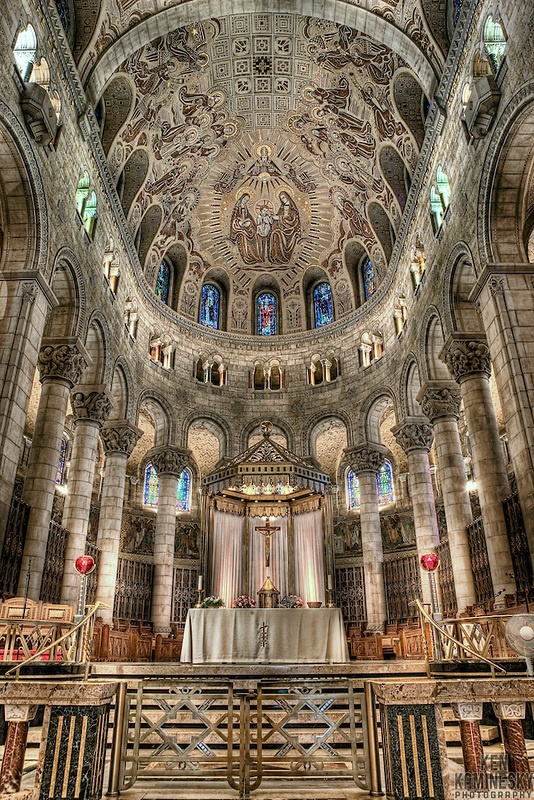 The Basilica of Sainte-Anne-de-Beaupré is set along the Saint Lawrence River in Quebec, Canada, 30 kilometres (19 miles) east of Quebec City. It has been credited by the Roman Catholic Church with many miracles of curing the sick and disabled. It is an important Catholic sanctuary which receives about a half-million pilgrims each year.  by Ken Kaminsky