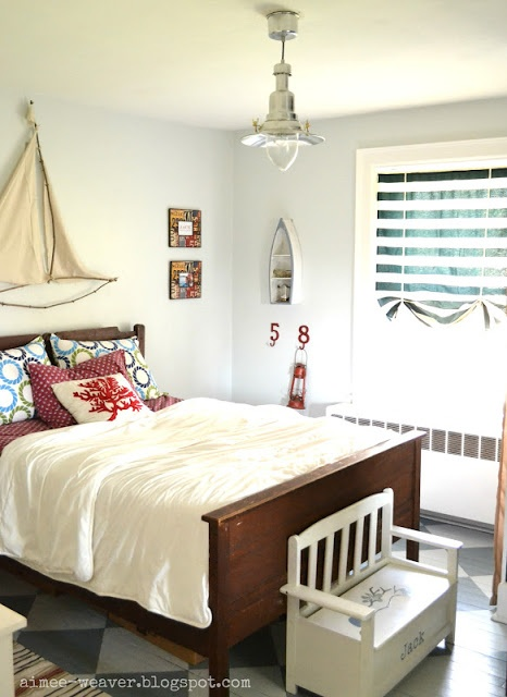 What a cute design for boys room..love how sail was made above bed