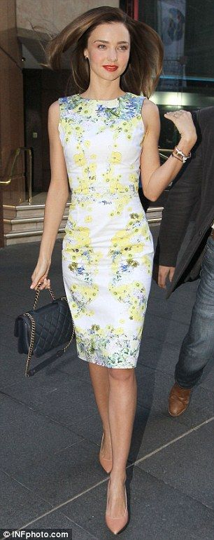 Chic and very feminine street style with a delicate floral print + Chanel bag on Miranda Kerr.