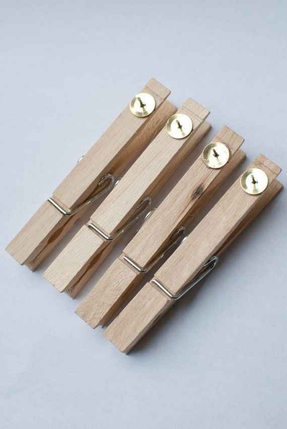 Glue thumbtacks onto clothespins