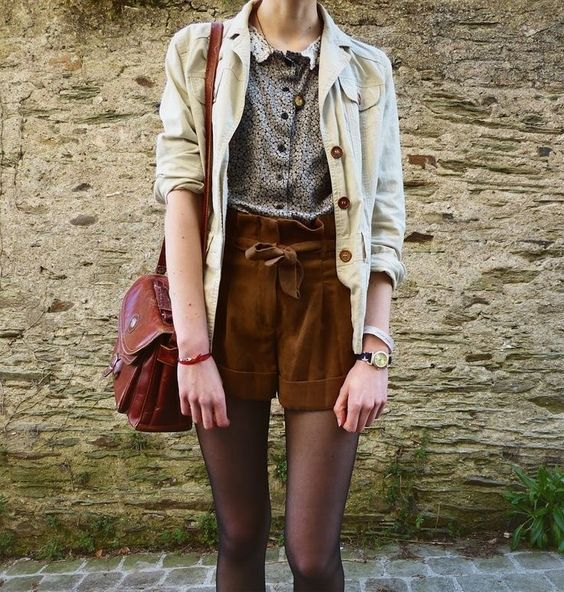 Brown suede shorts, flowery shirt, denim jacket and brown leather handbag