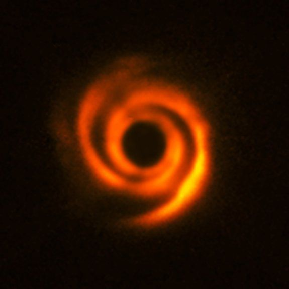 The planet-forming disk around the star HD 135344B, which is about 450 light-years away, has a spiral structure that was most likely created by protoplanets on their way to becoming Jupiter-like bodies. The central star is obscured in this image from the SPHERE instrument on ESO's Very Large Telescope in Chile.