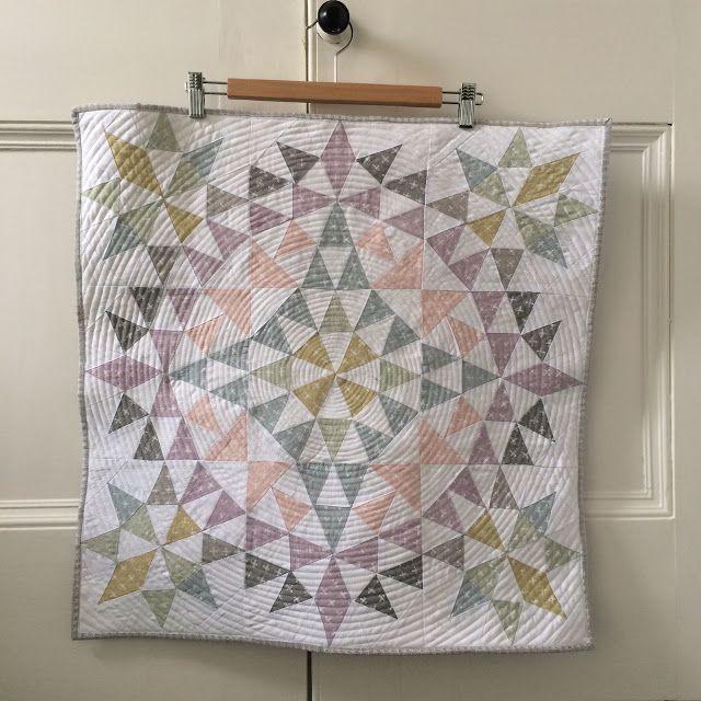 Karen LewisTextiles: Scandinavian Oakshott with Karen's own screen printing then pieced with the kaleidoscope block pattern