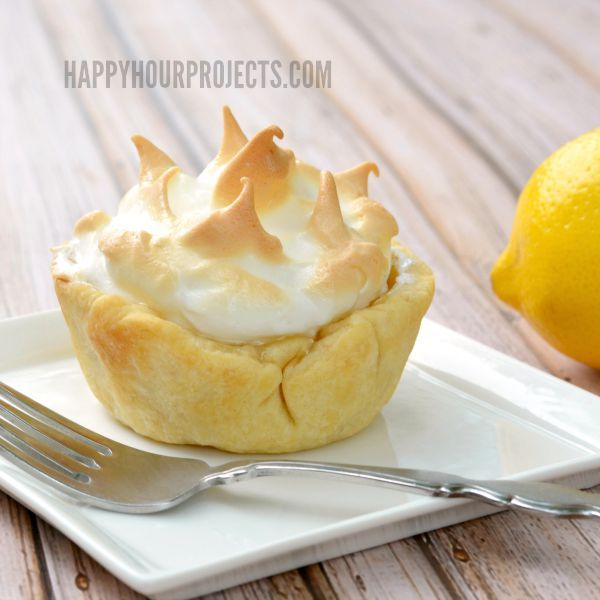 Lemon Meringue Mini Pies for National Lemon Meringue Pie Day at www.happyhourprojects.com