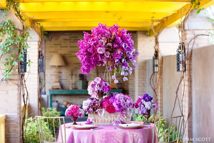 Purple and gold inspired tablescape.  Love this flower combination for wedding centerpieces.