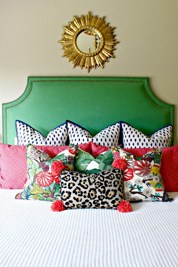 THE SECRET TO PRETTY PILLOWS {AND A MONEY SAVING TIP}  ||  green upholstered headboard  || alabaster chiang mai dragon pillows  ||  palm pillows  ||  skin tight ebony leopard pillow  ||  pom pom pillow