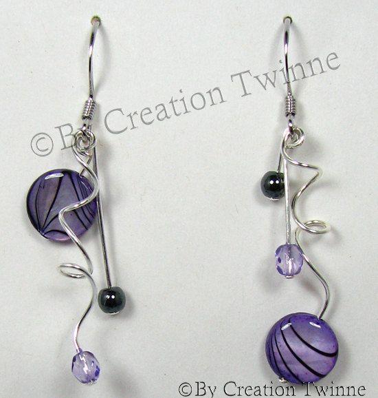 19.50$ ETSY 10% discount promo code is PIN10, purple earrings, purple spiral earrings, bridesmaids earrings, mother gift, wedding jewelry, asymmetrical earring, purple funky earrings by creationtwinne # GET IT HERE: http://www.etsy.com/listing/116848920/