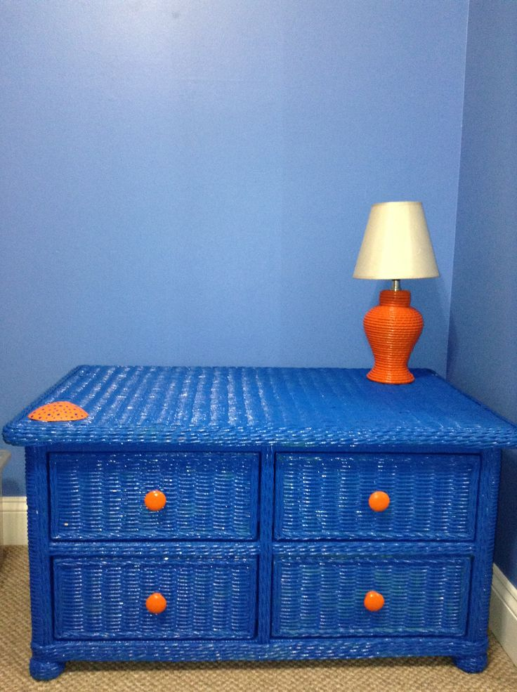 Orange and blue spray painted wicker furniture, wooden knobs, wicker lamp and a painted seashell, by Sheila's Garden Girls LLC in Ocean City NJ. Please like us on Facebook.