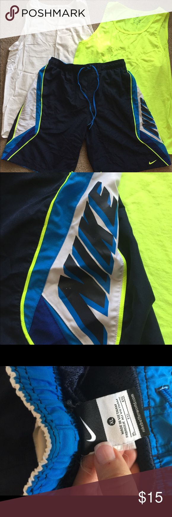 Nike Men's Swim trunks and 2 tanks Great condition but doesn't fit anymore.  Trunks are XL and tanks are L Nike Swim Swim Trunks