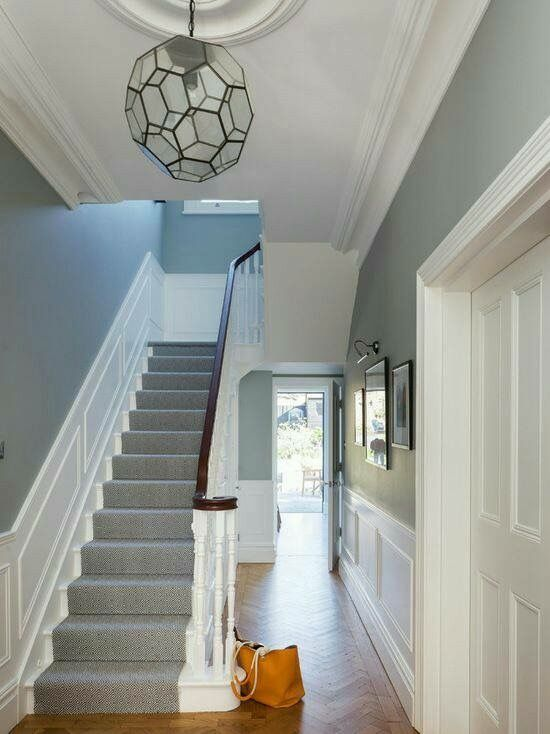 The color on the right side and the molding along the ceiling