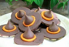 Halloween Dessert Ideas - For HALLOWEEN Witch Hat cookies! Cookie ingredients are Keebler Fudge stripe cookies (turned upside down), Hershey Kisses attached with orange Wilton tube icing. Soooo easy!