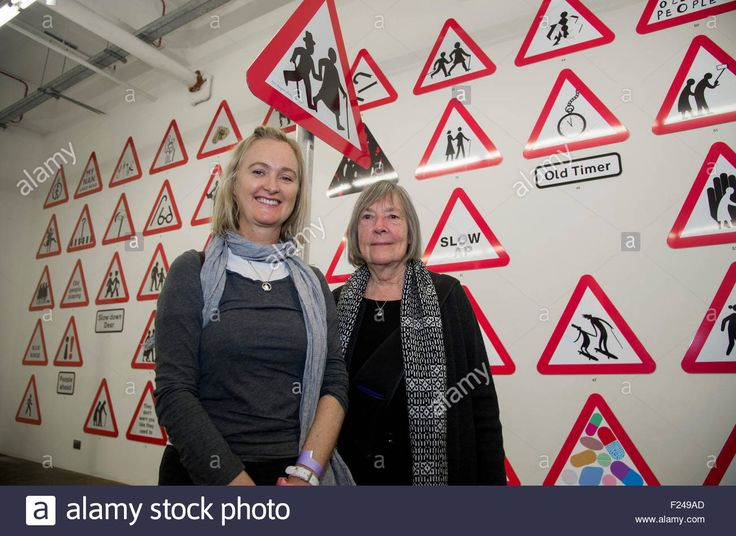Margaret Calvert (right), designer of the modern British road sign 10th September, 2015.    www.springchicken.co.uk in collaboration with NB Studio presented Sign of the Times, an exhibition of 100  re-imagined 'elderly people' road signs from more than 70 international designers. Spring Chicken is lobbying the Department for Transport to update the 'outdated' current sign with something more appropriate for older people in the 21st century. The exhi...