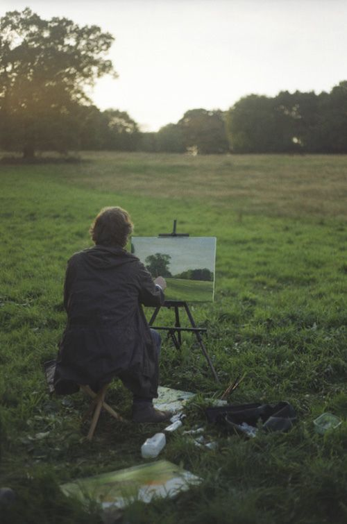 artist painting outdoors in sunset
