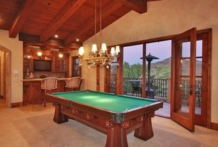 Mediterranean Game Room with Chandelier, Sherwin Williams Faux Finish Crackle, Exposed beam, limestone floors, High ceiling