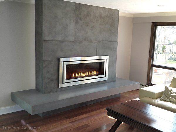 Concrete fireplace surround with a Regency Fireplace and floating hearth. Concrete Fireplace Surrounds -Trueform Concrete Custom Work