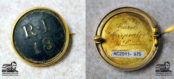 "The Royal Irish Regiment, also known as the 18th Regiment of Foot, was originally formed raised in 1684 in Ireland and served nobly until being disbanded in 1922.   This button comes from the collection of the Abraham Lincoln Presidential Library and features ""RI / 18"" on the front which is set into a gold tone metal pin back. The reverse side of the button features the engraving, ""Carol Carpenter / St. Louis""."