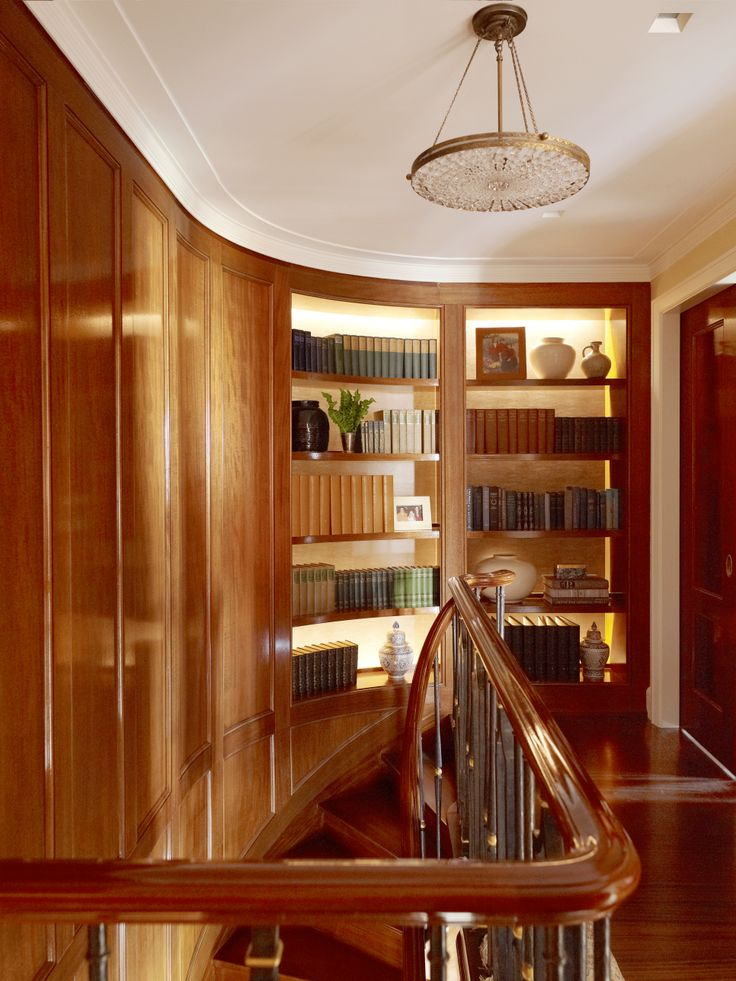 These traditional bookshelves make for an elegant entrance to the upstairs of this formal living space in New York City's Central Park West.