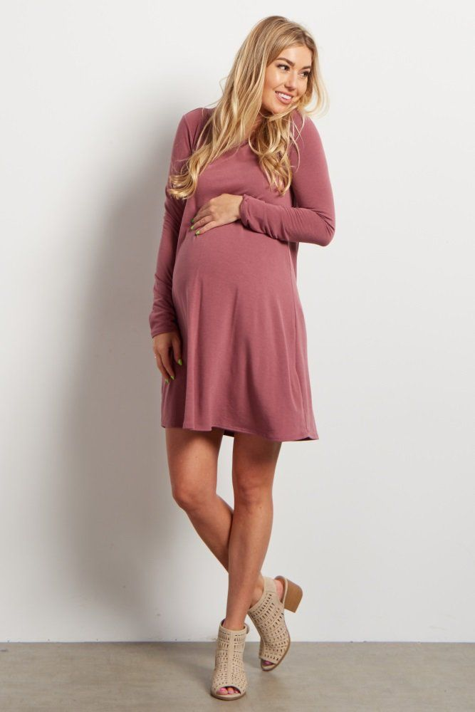 This pretty long sleeve maternity dress is a must-have staple piece you will want to have in your closet. Pair this dress with your favorite flats or heels and you will have a gorgeous look you can wear to any occasion.