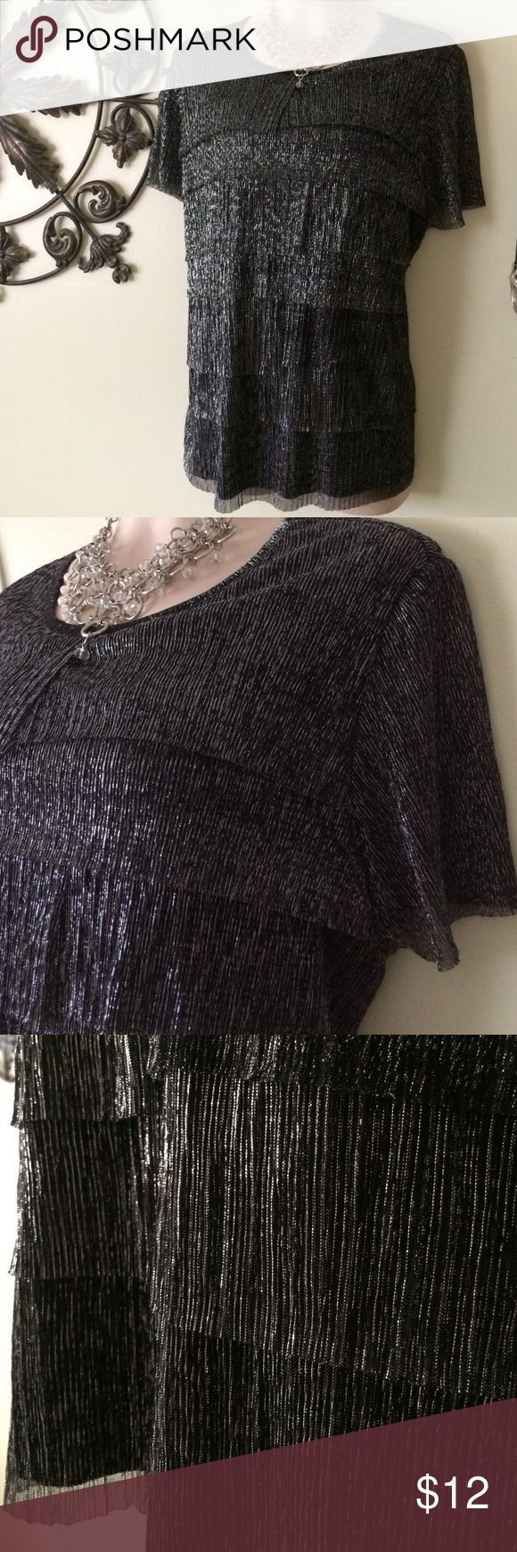 Alfred Dunner Top Beautiful black and silver short sleeve top. Fully lined except for sleeves. 100% polyester. Very sharp with black slacks or skirt.  Light weight and cool. Travels well. . Excellent condition. Alfred Dunner Tops