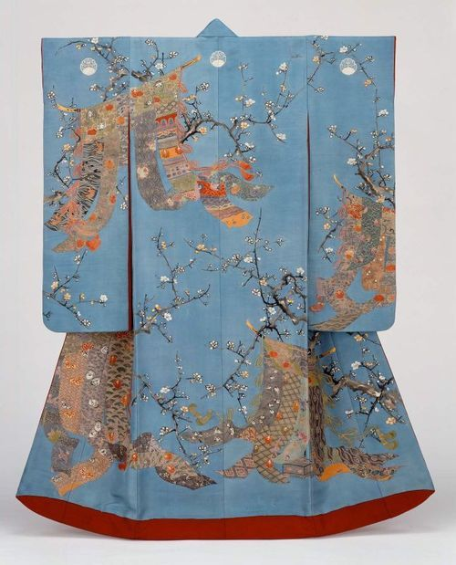 """One of the most popular froms of kimono is the furisode, worn by an unmarried young woman at festivals, tea ceremonies, or any other formal event. Furisode literally means """"swinging sleeves"""" and it is marked not only by its long sleeves, but by its bright colors and decoration."""
