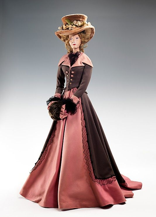 """""""1787 Doll"""" with costume by Mendel / Rose Valois, made in 1949 as part of the Friendship Train. This dress was inspired by Philibert-Louis Debucourt's painting """"La Promenade au Palais Royal."""" Debucourt (1755-1832) was a French printmaker and social satirist known for his depictions of French society. """"La Promenade au Palais Royal"""" caricatures the indulgent and frivolous nature of French society including prostitutes and other undesirables leading up to the French Revolution."""