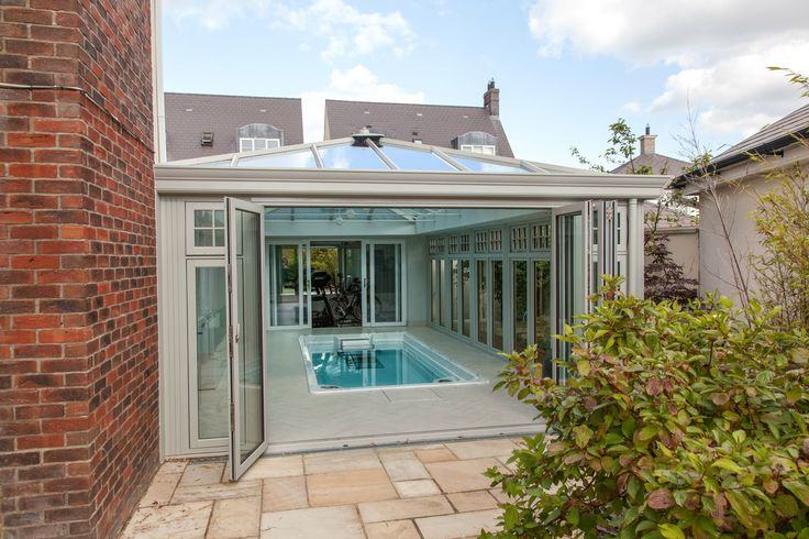 Photo 1 of 5 featuring the Endless Pool swim spa in a beautiful glass conservatory.  Build your own swim spa with our online configurator and explore the possibilities for your space: http://www.endlesspools.com/swim-spa-prices.php