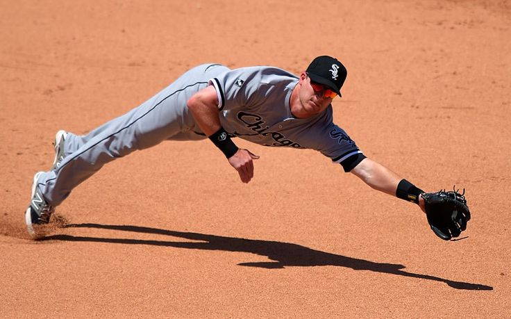 Stretch it like Beckham. Chicago White Sox second baseman Gordon Beckham can't reach a ball hit by Los Angeles Angels' Josh Hamilton during the fifth innings of a baseball game in Anaheim, California
