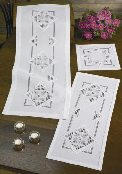 Subtle shading in large motifs adds interest to these crisp white mats.